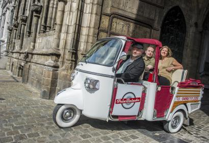 Guided visit of Mons by tricycle Triobalade